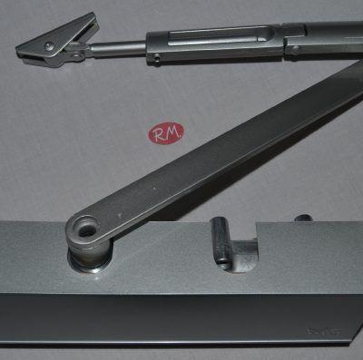 Cierrapuertas plata Dorma TS-71 con retenedor